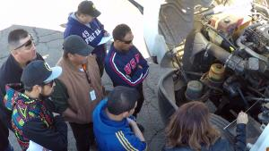 Alma Luna reviews the Engine Compartment inspection with students.